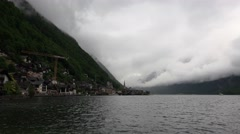 4k Deep alps mountain clouds panning shot at Hallstatt lake Stock Footage