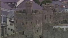 AERIAL United Kingdom-Caernarfon Castle Stock Footage