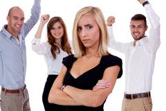 Young businesswoman bullying mobbing by team isolated Stock Photos