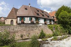 Oberhof Chapel and halftimbered houses on the river Weiss Kaysersberg Alsace Stock Photos