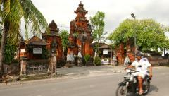 Beautiful temple at Bali street, pan shot, camera move Stock Footage