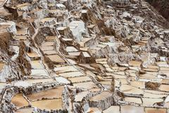 Salt pans in the Sacred Valley of the Incas on the Urubamba at Maras Peru South - stock photo