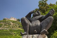 Sculpture Bacchus in front of the vineyard with Staufen castle Staufen im - stock photo