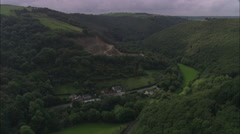 AERIAL United Kingdom-Wooded Valley At Pentre Morgan Stock Footage