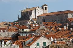 Jesuit Church view from the city walls historic centre Dubrovnik Dalmatia - stock photo