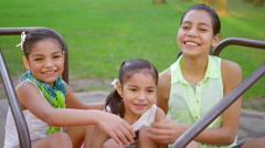 Young girls smiling on a merry-go-round Stock Footage