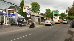 Dense traffic on balinese street, Denpasar outskirts Stock Footage