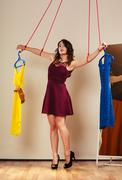 Addicted to shopping woman girl marionette with clothes Stock Photos