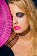 Young beautiful woman with smokey eyes and pink lips Stock Photos