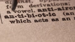 Antibiotic - Fake dictionary definition of the word with pencil underline - stock footage