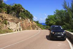 Stock Photo of Rent car on a new road of the Praslin island