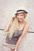 happy young blonde woman with hat outdoor summertime - stock photo
