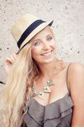Stock Photo of happy young blonde woman with hat outdoor summertime