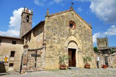 Church of Santa Maria Assunta in Piazza Roma Monteriggioni Province of Siena - stock photo
