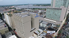 Aerial pan past Mississippi River over famous Canal Street to cityscape Stock Footage