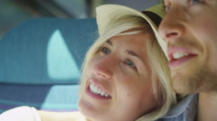 Close up of woman resting on her partners shoulder on a train in slow motion Stock Footage