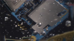 Stock Video Footage of A torn apart cell phone suspended in a clear substance with bubbles