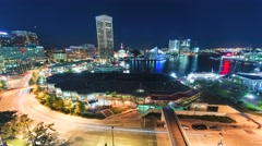 Aerial view timelapse of Baltimore Inner Harbor at night Stock Footage