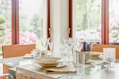 Crystal stemware and porcelain tableware Stock Photos