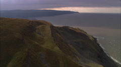 AERIAL United Kingdom-Exmoor Coastline With Forest Down To Shoreline Stock Footage