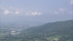 AERIAL Spain-San Sebastian Revealed Beyond Mountain Ridge - stock footage