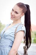 young attraktive happy woman outdoor in summer - stock photo