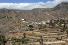 Stock Photo of View of terraced fields and Alojera Montana de Retamar with trade wind clouds
