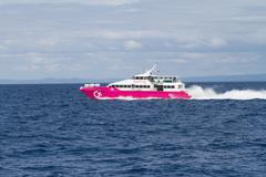 Stock Photo of Editorial - Ferry Speeding Past Bohol Island, Philippines