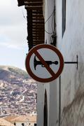 No Car Horns Sign On Building Cusco Peru - stock photo