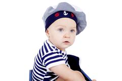 Stock Photo of cute little baby in sailor fashion playing
