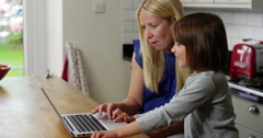 Mother and daughter on a laptop Stock Footage