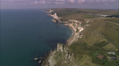 AERIAL United Kingdom-Coast And On To Durdle Dor - stock footage