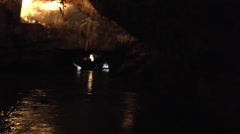A Boat Moves Deeper into a Cave Stock Footage