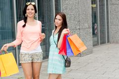 Two attractive young girls women on shopping tour Stock Photos