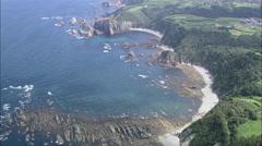 AERIAL Spain-Looking Back Over Rocky Coastline Stock Footage