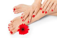 Woman with beautiful red manicured nails Stock Photos