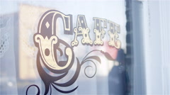 Cafe sign painted on a window - stock footage