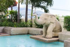 elephant statue spouting water - stock photo