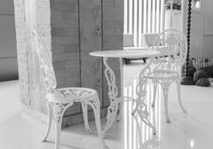 White table and chair sculpturing tracery Stock Photos