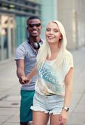 Stock Photo of happy young couple have fun in the city summertime
