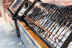 Charcoal stove and gridiron for barbecue grilling Stock Photos