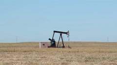 Oil Pumpjack on the prairie. Alberta, Canada. Stock Footage