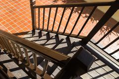 Bannister shadow on wooden stair step Stock Photos