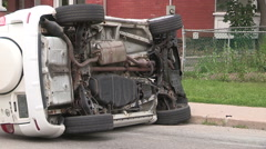 SUV rolled over in minor car accident in city. Stock Footage
