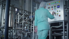 Milk factory bottling milk in glass bottles 13 5 Stock Footage
