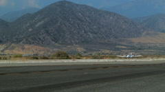 Twin-Engine Airplane Takes Off Stock Footage