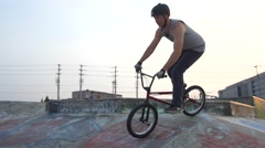 BMX Trick - tailwhip on quarter pipe- Extreme Sports Stock Footage