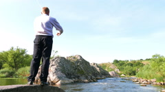 Businessman     meditate  near nice river in summer day . 4K 3840x2160 - stock footage