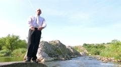 Businessman     meditate  near nice river in summer day . 4K 3840x2160 slow mot - stock footage