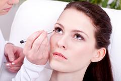 at the cosmetic studio eyeliner on eyes make up - stock photo